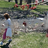 "Beck Diefenbach  -  bdiefenbach@daily-chronicle.com<br /> <br /> Dolan Hereck, 4, and his mother Erin, of Sycamore, walk along a steam near the NIU Lagoon on the Northern Illinois University campus in DeKalb on Friday April 17, 2009. ""It's a beautiful day and wanted to get out,"" Erin Hereck said. It was Dolan's first time at the lagoon."