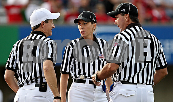 Rob Winner – rwinner@daily-chronicle.com<br /> Sarah Thomas meets with two other officials during the third quarter of the Northern Illinois-Idaho game on Saturday at Huskie Stadium.<br /> 09/26/2009