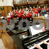 Rob Winner – rwinner@daily-chronicle.com<br /> Members of the Celebration Chorale led by director Christine Monteiro, practice on Wednesday November 25, 2009 at the First United Methodist Church of DeKalb.