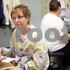 Beck Diefenbach  -  bdiefenbach@daily-chronicle.com<br /> <br /> Registered Nurse Nancy Reh talks with a patient after performing a blood test at the DeKalb Clinic in DeKalb, Ill., on Monday April 20, 2009.