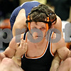 Rob Winner – rwinner@daily-chronicle.com<br /> DeKalb's Dalton Watie (front) tries to free himself from the grasp of Prospect's Brandon Thompson during their 152-pound match at the Don Flavin Wrestling Tournament in DeKalb, Ill. on Tuesday December 29, 2009.