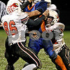 Rob Winner – rwinner@daily-chronicle.com<br /> <br /> Genoa-Kingston running back Rob Thurlby is wrapped up by Stillman Valley defenders in the second quarter of Friday night's game.<br /> <br /> 10/16/2009