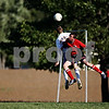 Rob Winner – rwinner@daily-chronicle.com<br /> <br /> Somonauk's Nathan Rogers (left) and Indian Creek's Dillon Martenson battle for control of a ball during the first half on Wednesday.<br /> <br /> 10/07/2009