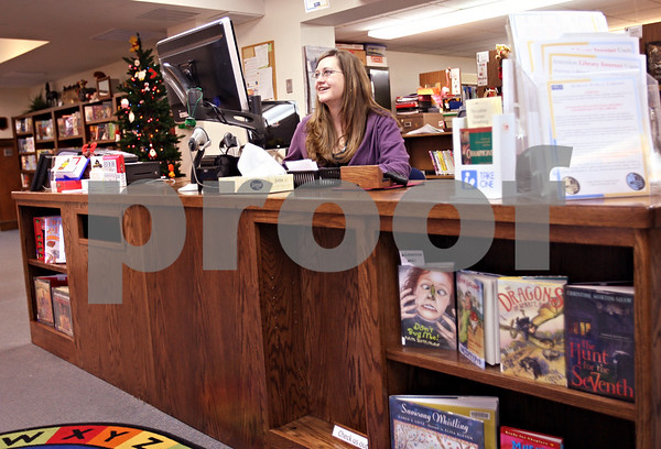 Beck Diefenbach  -  bdiefenbach@daily-chronicle.com<br /> <br /> Circulation clerk Darcy Tatlock works from the new desk at the children's section of the DeKalb Public Library in DeKalb, Ill., on Friday Dec. 4, 2009.