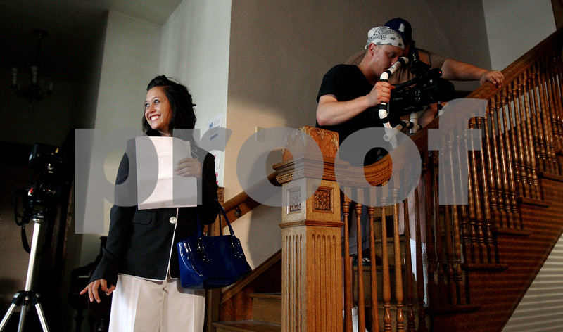 Rob Winner – rwinner@kcchronicle.com<br /> Amanda Brown (from left) waits as Michael Gentile and Kevin Oakes prepare a camera during filming at the old Sycamore Hospital on Saturday. The film is for a thesis by NIU student Jennifer Rayphole (not pictured).<br /> 07/18/2009