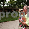Beck Diefenbach  -  bdiefenbach@daily-chronicle.com<br /> <br /> DeKalb native and NBC Sports golf analyst Mark Rolfing, right, embraces his wife Debi outside his childhood home on Lawnwood Avenue in DeKalb, Ill., on Tuesday Aug. 17, 2009. Rolfing lived in the house when his father died in a plane crash on Nov. 29, 1960. Rolfing will be announcing at this week's Solheim Cup.