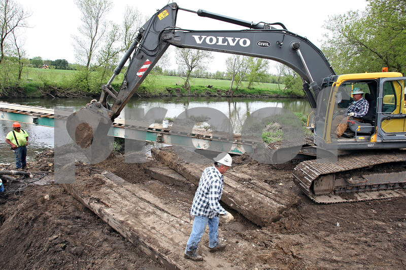 Beck Diefenbach  -  bdiefenbach@daily-chronicle.com<br /> <br /> Civil Construction excavator operator Joe Boryer prepares a platform during construction of a bridge on the Kishwuakee River north of Sycamore, Ill., on Tuesday May 5, 2009.