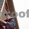 Beck Diefenbach – bdiefenbach@daily-chronicle.com<br /> <br /> Sycamore High School senior Steven Tyrrell attaches siding above the garage door of the project house in Sycamore, Ill., built in the construction trades class through the Kishwaukee Education Consortium on Tuesday March 10, 2009.