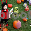 Rob Winner – rwinner@daily-chronicle.com<br /> <br /> Norah Chami, 1, of Sycamore, looks at the many pumpkin entries during the first day of the Pumpkin Festival on Wednesday.<br /> <br /> 10/21/2009