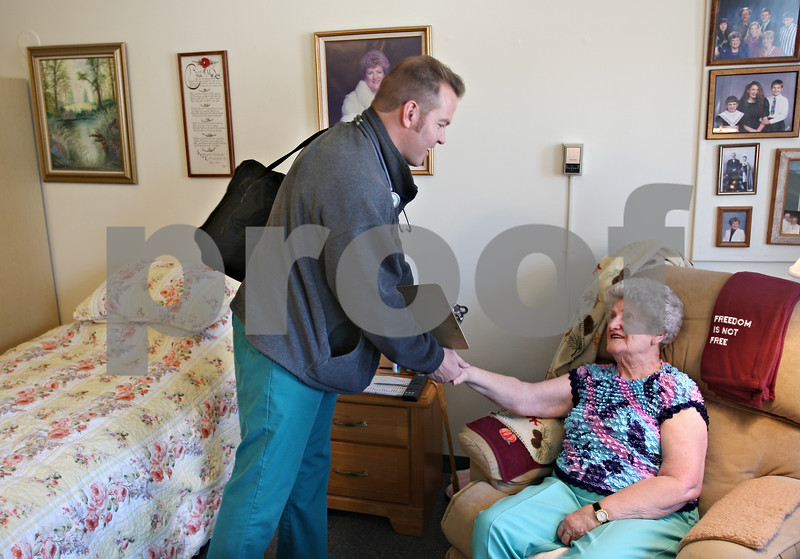 Beck Diefenbach  -  bdiefenbach@daily-chronicle.com<br /> <br /> Elaine Davis, 81, thanks Registered Nurse Gary Ketchum following a home health visit check up at Davis' apartment at Barb City Manor in DeKalb, Ill., on Thursday Feb. 5, 2009.