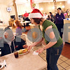 "Beck Diefenbach  -  bdiefenbach@daily-chronicle.com<br /> <br /> Tanya Ottoman-Towne serves dinner to Ricky Rodriguez during the community dinner at Flippin Eggs in DeKalb, Ill., on Wednesday Dec. 23, 2009. ""Better than being alone,"" Rodriguez said."