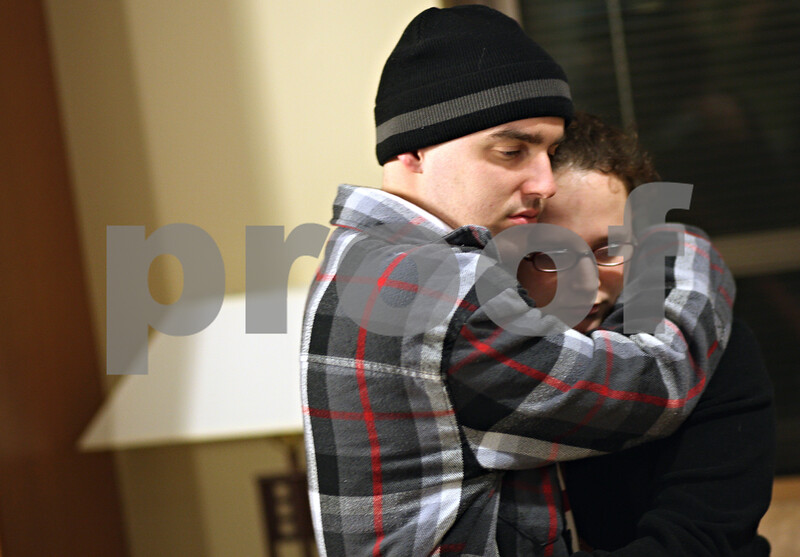 Beck Diefenbach  -  bdiefenbach@daily-chronicle.com<br /> <br /> Kevin hugs his girlfriend Erika Sorg at Kishwaukee Community Hospital on Friday April 10, 2009. Erika flew in from New York to be will Kevin as he underwent Chemotherapy at the hopital.