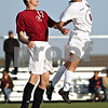 Beck Diefenbach  -  bdiefenbach@daily-chronicle.com<br /> <br /> Genoa-Kingston's Frankie Beltran (6, right) Northridge's Paul Carter (13) leap for the ball during first half of the regional playoff game at GK High School in Genoa, Ill., on Tuesday Oct. 13, 2009. After two overtime periods, the game was suspended due to darkness and will be restarted on Thursday at 4:30 P.M. at Genoa-Kington High School.