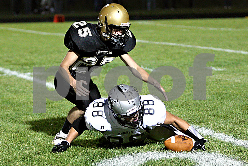 Rob Winner –  rwinner@daily-chronicle.com<br /> Kaneland's Ryley Bailey (88) recovers his muffed punt return in the first half as Sycamore's Nick Weber tries to make a play.<br /> 09/18/2009