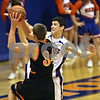 Beck Diefenbach  -  bdiefenbach@daily-chronicle.com<br /> <br /> Genoa Kingston forward Gage Windau (4) attempts to stop a shot by Byron forward Adam Head (34) during the third quarter of the game at GK High School in Genoa, Ill., on Thursday Feb. 5, 2009.