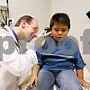 Rob Winner – rwinner@daily-chronicle.com<br /> <br /> Physician assistant David Wester examines Jovanny Sangabriel, 5, of Sycamore, at the new Community Cares Clinic in DeKalb on Monday October 19, 2009.