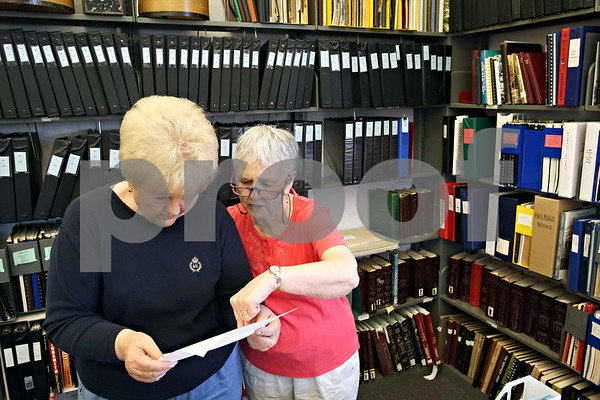 """Beck Diefenbach  -  bdiefenbach@daily-chronicle.com<br /> <br /> County historian Phyllis Kelley (right) shows Martha Waymire (right), of Bella Vista, Ark., a document concerning early Sycamore settler """"Lysander Darling"""" at the Joiner History Room in the Sycamore Library in Sycamore , Ill., on Thursday April 30, 2009. Waymire's son now lives on Darling Court in Sycamore and was curious about the origin of the street's name."""