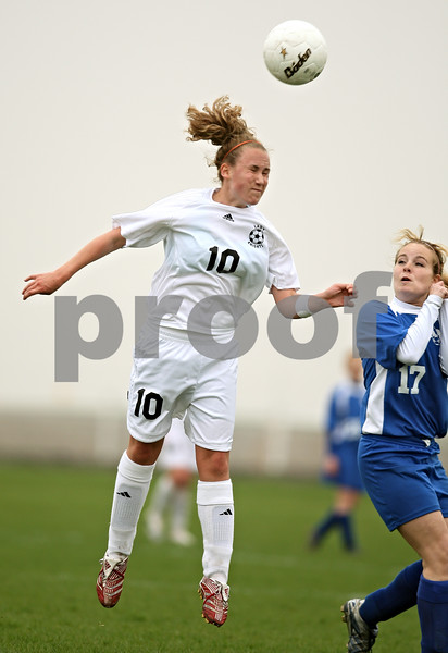 Beck Diefenbach  -  bdiefenbach@daily-chronicle.com<br /> <br /> Kaneland's Colleen Gebauer (10) heads the ball above Hinckley-Big Rock's Olivia Bye (17) during the first half of the game at Kaneland High School in Maple Park, Ill., on Wednesday April 29, 2009.