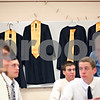 Beck Diefenbach  -  bdiefenbach@daily-chronicle.com<br /> <br /> Gowns hang behind graduating seniors before the ceremony at Sycamore High School in Sycamore, Ill., on Sunday May 31, 2009.