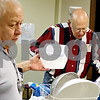 "Rob Winner – rwinner@daily-chronicle.com<br /> Joe Villa (left) takes a container from Warren Lowe while the two work together preparing a Christmas dinner at the Sycamore United Methodist Church in Sycamore, Ill. on December 24, 2009. Lowe, a Sycamore resident, recently placed a classified ad in the Daily Chronicle, looking for roommates. He wants them all to be fellow senior citizens so they ""could help take care of each other."""