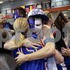 Beck Diefenbach – bdiefenbach@daily-chronicle.com<br /> <br /> Will Dowling, of Batavia, hugs Hinckley-Big Rock's Jes Meyer after she and her team beat Dakota High School in the 1A Super Sectional game at Elgin Community College in Elgin, Ill., on Monday Feb. 23, 2009.