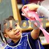 Beck Diefenbach  -  bdiefenbach@daily-chronicle.com<br /> <br /> Brianna McCollum, 3, gets her fingers into some play puddy while attending day care at the Children's Learning Center in DeKalb, Ill., on Monday Jan. 26, 2008.
