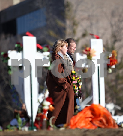 Beck Diefenbach  -  bdiefenbach@daily-chronicle.com<br /> <br /> Eric and Mary Kay Mace, parents of Ryanne Mace, walk past the five crosses during the presentation of the memorial wreaths outside Cole Hall on the campus of Northern Illinois University in DeKalb, Ill., on Saturday Feb. 14, 2009.