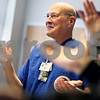 Beck Diefenbach – bdiefenbach@daily-chronicle.com<br /> <br /> Jack Case, volunteer hospice worker, claps along during a movement exercise during an in-service meeting for hospice volunteers at the DeKalb County Hospice building in DeKalb, Ill., on Thursday Feb. 5, 2009.