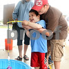 Beck Diefenbach  -  bdiefenbach@daily-chronicle.com<br /> <br /> Dan Cadena, 3, gets help from his brother A. J., 10, during a fishing game at the Sandwich Freedom Days in downtown Sandwich, Ill., on Saturday  July 4th, 2009.