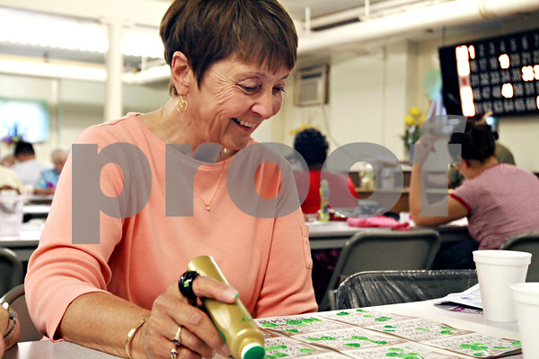 Randi Stella – rstella@daily-chronicle.com<br /> <br /> Carol Niles, 66, marks surveys her bingo cards during Bingo Night at St. Mary's school in DeKalb, Ill., Monday, June 6th, 2009.
