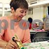 Randi Stella – rstella@daily-chronicle.com<br /> <br /> Carol Niles, 66, marks surveys her bingo cards during Bingo Night at St. Mary's school in DeKalb, Ill., Monday, June 6th, 2009.