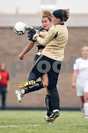 Beck Diefenbach  -  bdiefenbach@daily-chronicle.com<br /> <br /> Crystal Lake Central's Erin Frazier, left, (17) collides with Sycamore goalie Sarah Fischer during the first half of the Belvidere Class 2A sectional semi-final game at Belvidere High School in Belvidere, Ill., on Wednesday May 27, 2009.