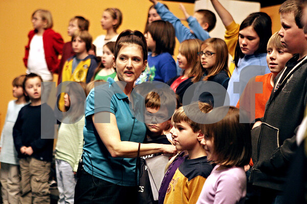 Rob Winner – rwinner@daily-chronicle.com<br /> Music director Sue Jacobson positions Waterman Elementary kindergarten students during a rehearsal for a holiday pageant at Indian Creek High School in Shabbona, ILL. on Tuesday December 8, 2009.