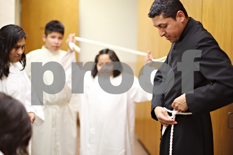 Beck Diefenbach  -  bdiefenbach@daily-chronicle.com<br /> <br /> Seminarian Juan Ayala shows his alter servers in training how to tie the rope belt around his waist during class at St. Catherine's of Genoa Church on Wednesday June 17, 2009.