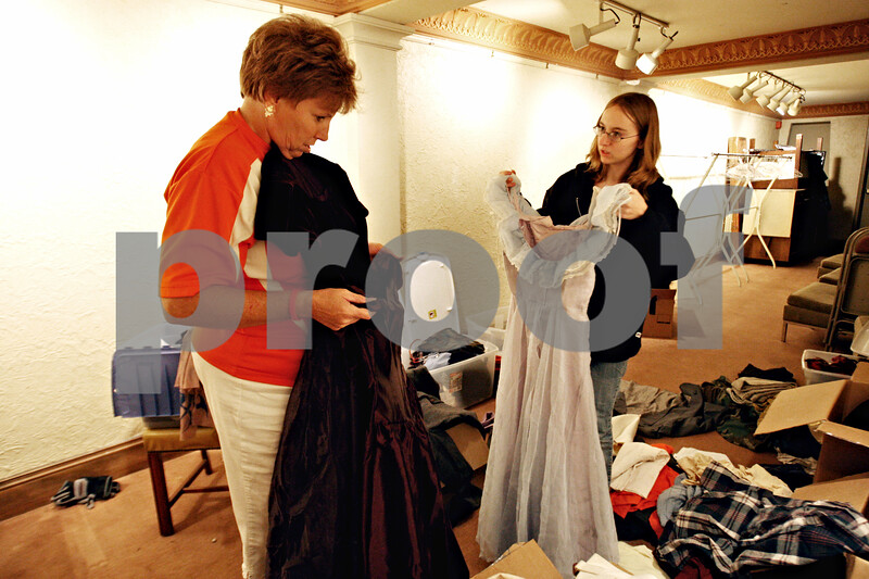 Rob Winner – rwinner@daily-chronicle.com<br /> <br /> Costume director Traci Grimes (left) and Kelly McKnight organize outfits for the actors of the Egyptian Theatre's haunted house which opens this Thursday in DeKalb.<br /> <br /> 10/19/2009