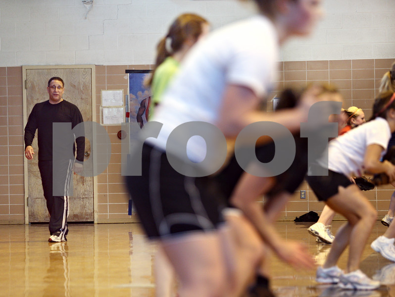 Beck Diefenbach – bdiefenbach@daily-chronicle.com<br /> <br /> Indian Creek head coach Fred Colon leads his players during practice at the Indian Creek Middle School gymnasium in Waterman, Ill., on Wednesday March 11, 2009.