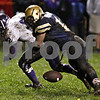 Beck Diefenbach  -  bdiefenbach@daily-chronicle.com<br /> <br /> North Shore Country Day School's Ben Shafer (82) looses the ball after he tackled by Hiawatha linebacker Angel Hernandez (11) during the second quarter of the game at Hiawatha High School in Kirkland, Ill., on Friday Oct. 23, 2009.