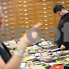 Beck Diefenbach  -  bdiefenbach@daily-chronicle.com<br /> <br /> Bill Feldman, of DeKalb, searches for images in magazines that relate to the story he is planning to write as part of National Novel Writing Month in Davis Hall on the campus of Northern Illinois University on Saturday Oct. 24, 2009.