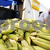 EMILY OLSON | emolson@daily-chronicle.com<br /> Adam Massier of the DeKalb of the Kiwanis Club prepare ears of corn to be roasted at Corn Fest at the DeKalb Taylor Municipal Airport on Aug. 22, 2008.