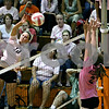 Rob Winner –  rwinner@daily-chronicle.com<br /> DeKalb's Courtney Thomas (12) looks for a kill in the third game.<br /> 09/22/2009