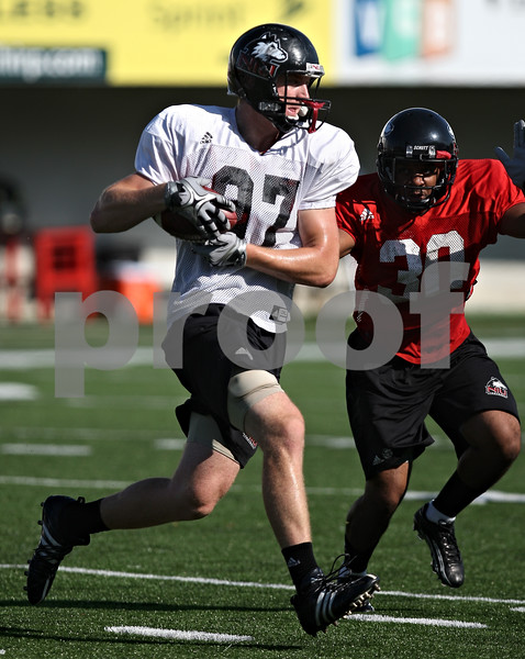 Beck Diefenbach  -  bdiefenbach@daily-chronicle.com<br /> <br /> Tight end Jack Marks (97) during practice at Huskie Stadium of Northern Illinois University in DeKalb, Ill., on Tuesday Sept. 1, 2009.