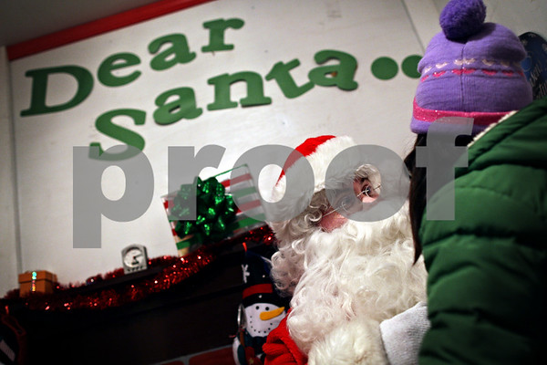 Beck Diefenbach  -  bdiefenbach@daily-chronicle.com<br /> <br /> Santa asks Jessalyn Foote, 5, of Sycamore, what she wants for Christmas at his post outside the DeKalb County Courthouse in Sycamore, Ill., on Friday Dec. 18, 2009. Foote asked Santa for some Nintendo Wii games and anything Tinker Bell.
