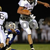 Beck Diefenbach  -  bdiefenbach@daily-chronicle.com<br /> <br /> Sycamore quarterback Ryan Bartels (6) slips by Burlington Central defenders during the first quarter of the game at Burlington Central High School in Hampshire, Ill., on Friday Sept. 4, 2009.