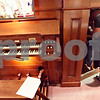 Beck Diefenbach  -  bdiefenbach@daily-chronicle.com<br /> <br /> Organ service technician Stephan Drexler, of Berghaus Pipe Organ Builders, enters the belly of the organ at St. Mary's of the Assumption Church in Maple Park, Ill., on Friday March 20, 2009. Drexler was tuning the organ in preparation of the future performance.