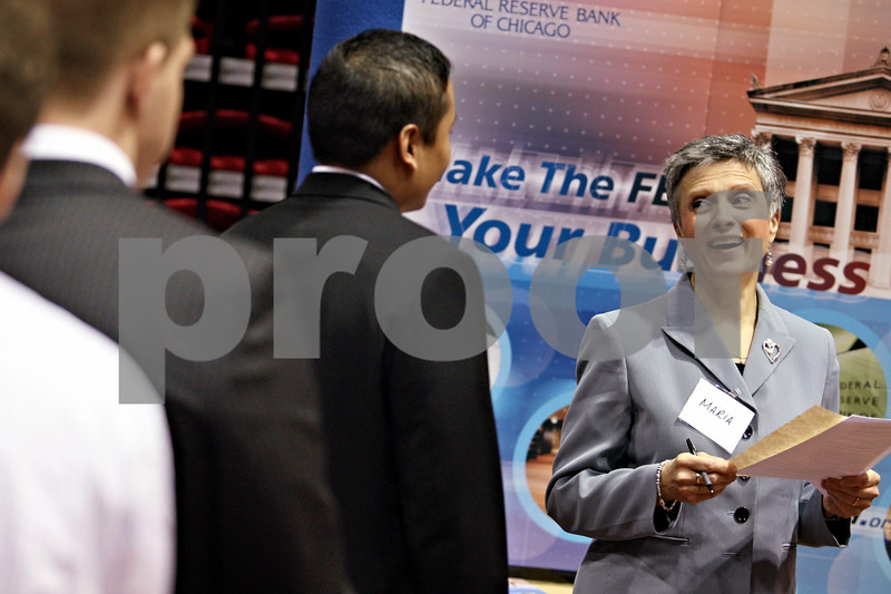 Beck Diefenbach – bdiefenbach@daily-chronicle.com<br /> <br /> Maria Hancock, senior recuiter for Federal Reserve Bank of Chicago, speaks with job seekers at the job fair at the Northern Illinois University Convocation Center in DeKalb, Ill., on Wednesday Feb. 25, 2009.
