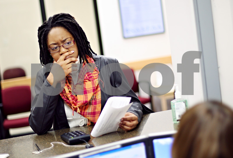 Beck Diefenbach  -  bdiefenbach@daily-chronicle.com<br /> <br /> Northern Illinois University acting student Melissa Cline discusses her aid status at the financial aid office at the NIU campus in DeKalb, Ill., on Friday April 3, 2009. Cline is planning on studying in Moscow for a semester an expects an increase in costs.