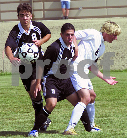 Chronicle photo ZACH HUSET<br /> Sycamore (8) Scott Horton is double teamed by Dekalb (8, 9) Saturday at Sycamore.