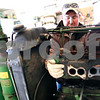 Beck Diefenbach  -  bdiefenbach@daily-chronicle.com<br /> <br /> Ben Anderson, of Waterman, lifts out pieces of the engine block of his tractor during an engine overhaul in the garage on his homestead in Waterman, Ill. Anderson is against the installation of wind turbines which may surround parts of his property.
