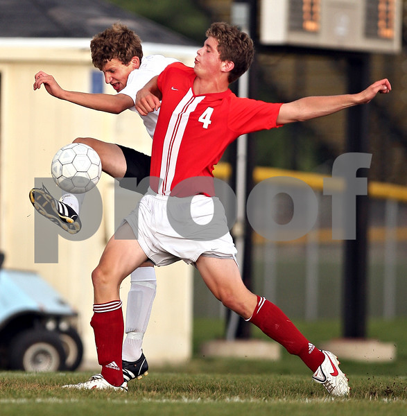 Beck Diefenbach  -  bdiefenbach@daily-chronicle.com<br /> <br /> Marmion's Sam Soliz (4, right) and Sycamore's Adam Westerby (16) battle for the ball during the first half of the game at Sycamore High School in Sycamore, Ill., on Tuesday Sept. 15, 2009. Sycamore tied with Marmion 0-0.
