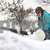 Beck Diefenbach  -  bdiefenbach@daily-chronicle.com<br /> <br /> Michael Baron-Jeffrey clears his driveway outside his home in DeKalb, Ill., on Friday Jan. 9, 2008.